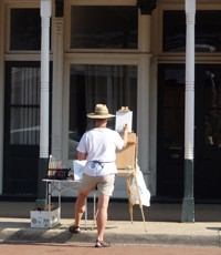 Belleville artist Brad Eilering at work on St. Louis Street in Lebanon on Saturday, Aug. 2, 2014.
