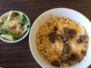 The Wisconsin Mac&Cheese with steak added with a Caesar salad. Photo Credit: Sarah Goetze