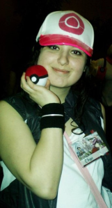 Charessa Sistek showing off her poke-a-ball at a local convention.