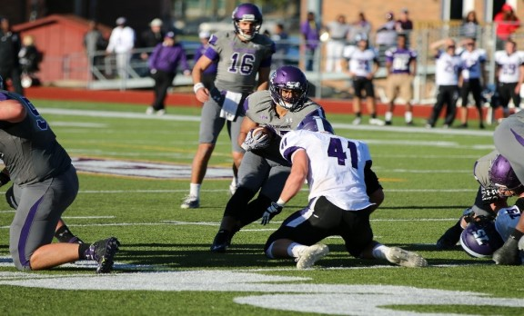 Junior running back Preston Thompson looks for running room vs. Truman State this past Saturday. Thompson led the charge offensively with 131 rushing yards and a touchdown. Photo credit: Scott Stokes
